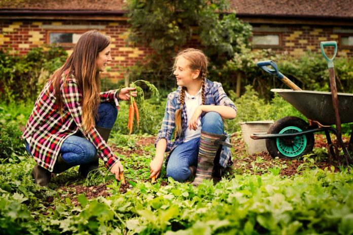 Mother and Daughter Enjoying Bonding Time Gardening Together | Family Life Tips Magazine